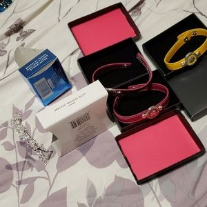 4 Avon bracelets, 2 violet, 1 yellow and 1 silver